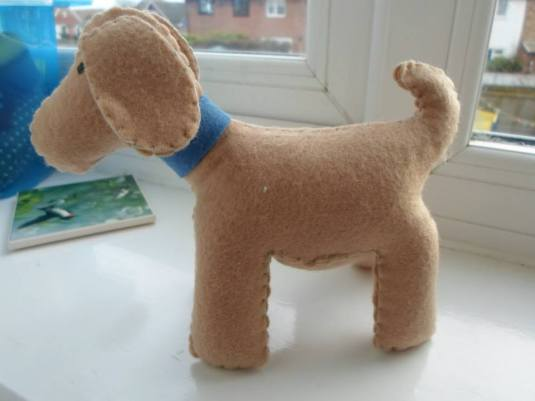 Handmade felt dog donated by Calico and Cotton