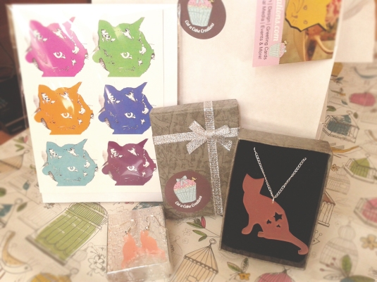 Laser cut pink frosted cat necklace, matching earrings and greetings card donated by Cat-a-Cake Creations. Worth £17