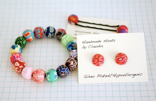 1 pair of fimo earrings, studs and a matching elasticated fimo bead bracelet. Worth £10.