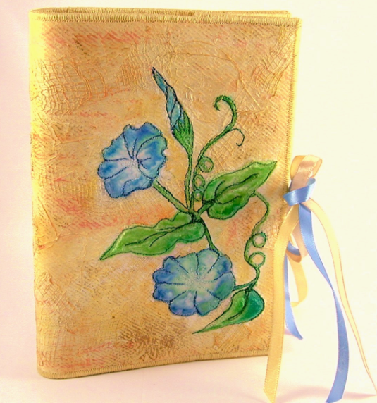 An embroidered note book donated by Georgie Arts